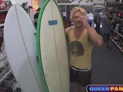 Surf dude sucks cock in pawn shop
