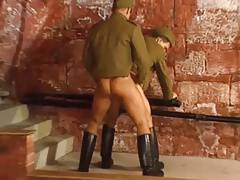 Soldiers and sailor in gay orgy.