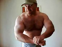 Hairy MuscleBear Dad Flexing