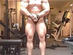 Str8 bodybuilder posing in the gym