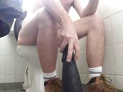 Big dildo ride public toilet