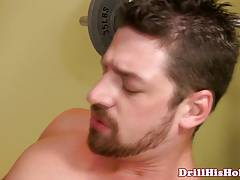 Hunky athlete handling cock