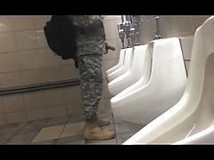 Soldier hardon in public bathroom.