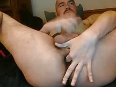 Bear jerking off and fingering ass