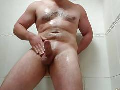 Chris Stroker oiling himself up in the shower