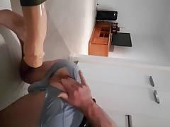 Fit guy rides big dildo