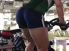 Blond perfection working hard on a bike